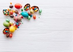 Easter concept. chocolate eggs and  colored sweets on a white background