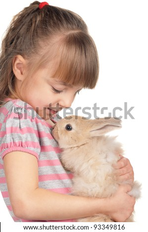 Easter concept image. Portrait of happy little girl with adorable rabbit over white background.