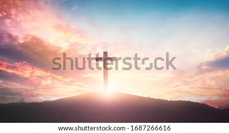 Photo of  Easter concept: The cross on mountain sunset background