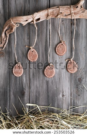 Easter cookies on dark background boards and straw