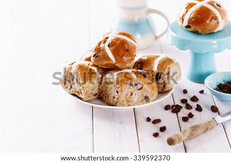 Easter cross-buns on white wooden background with copy space. Selective focus, shallow depth of field