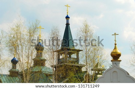 Easter crosses and domes of church and spring leaves