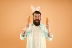 Easter customs. Spring sale. Perfect health food. Good source of beta carotene. Spring is coming. Buy vegetables. Organic farm. Easter holiday. Easter bunny with carrot. Man long ears rabbit
