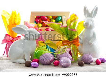 easter decoration. assorted eggs and bunnies on white background