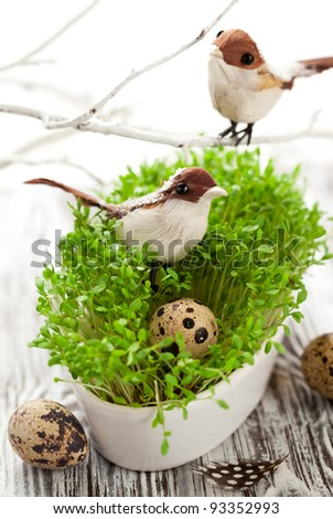 Easter decoration: birds and eggs on the fresh cress - stock photo