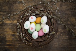 Easter decoration, Easter eggs, twigs on wood