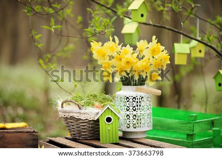 Easter decoration with spring flowers, narcissus blooms. Spring flowers in pots in the garden. Easter Sunday