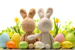 Easter decoration with sugar rabbits,eggs and flowers.