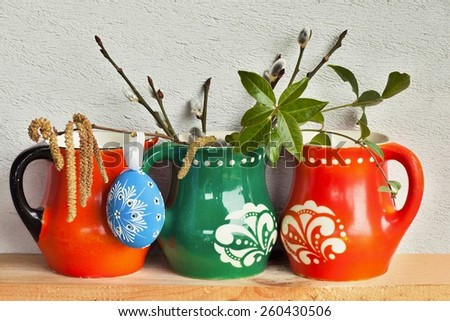 Easter decoration with variegated mugs,egg and catkins