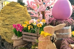 Easter decorative pink egg, willow branches, wooden bunny rabbit, yellow willow huge egg, wooden barrel, flower box and pink flower tree