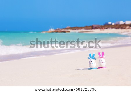 Easter, Easter eggs on the beach, ocean, sea #581725738