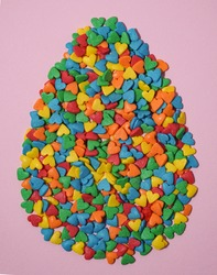 Easter Egg form from colorful heart shape sweet candy. Happy Easter Day card concept. Copy space for text. Minimal concept.