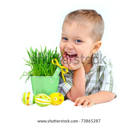 Easter egg hunt. Cute little boy with Easter eggs and basket the green spring grass Isolated on white background