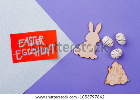 Easter egg hunt text. Easter card, plywood rabbit cutouts and styrofoam eggs. Easter egg hunt ideas. #1053797642