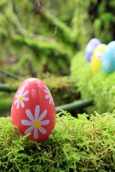Easter egg in a mossy forest.