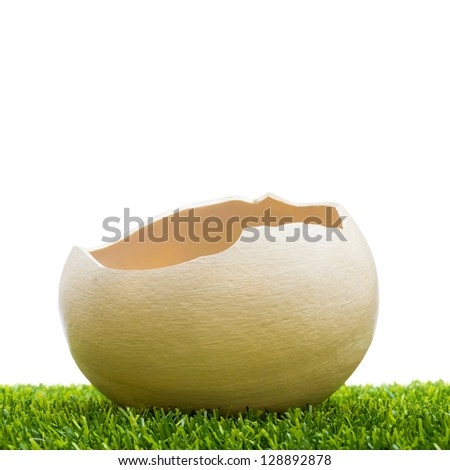 Easter egg in grass on white background