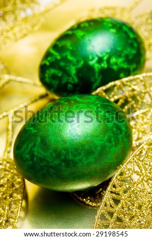 Easter egg with golden leaves