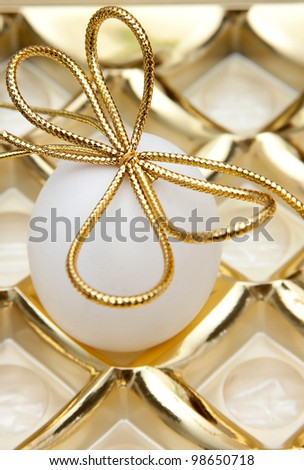 easter egg with golden ribbon