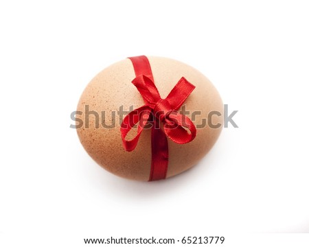 Easter egg with red ribbon on white background