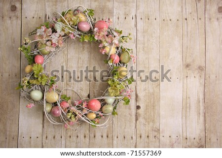 Easter egg wreath on a wooden background.