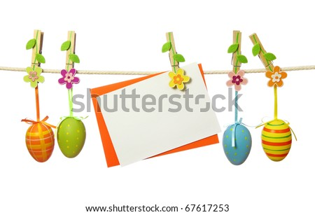 Easter eggs and blank note hanging on the clothesline isolated on white background