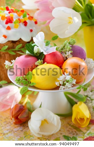 easter eggs  and cake on festive table
