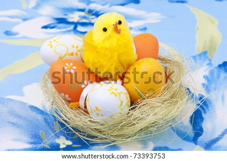Easter eggs  and chicken in a nest