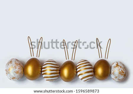 Easter eggs and easter bunny on white background with copy space. Easter background. Top view
