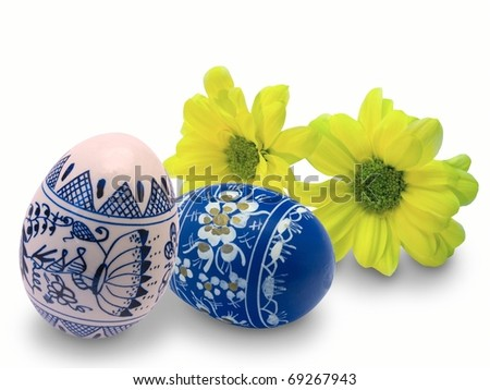 Easter eggs and flowers on a white background