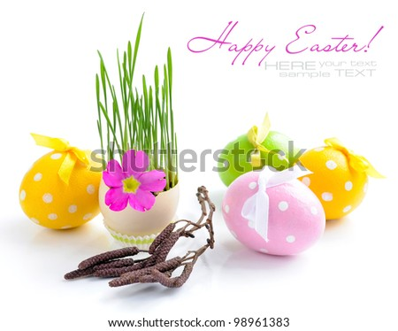 Easter eggs and green sprouts on a white background