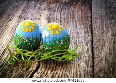 Easter eggs and  natural wooden country table, background and texture