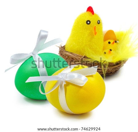 Easter eggs and nest with a hen and chickens on white background