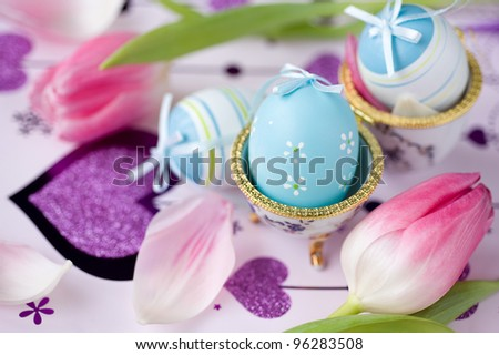 Easter eggs and pink tulips - stock photo