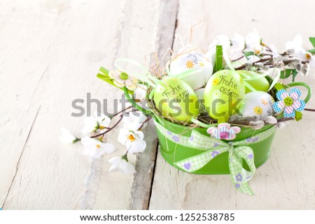 Easter eggs and tulips on wooden planes..German text happy easter #1252538785