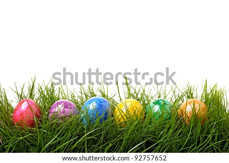 Easter eggs are colored in green grass