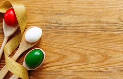 Easter eggs as the color of the Italian flag - green, white, red. Happy Easter holiday card