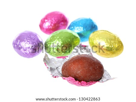 easter eggs chocolate candy unwrapped in foil isolated on white background