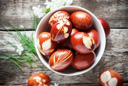 Easter Eggs Decorated with Natural Fresh Leaves and Boiled in Onions Peels, top view