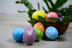 Easter eggs decoration on Easter day. With Copy paste for your text or design. Background of colorful Eastereggs in a wooden rattan basket. Happy Easter Day concept.