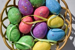 Easter eggs decorative in a basket. Easter eggs decorative texture background. Decorative easter eggs close up