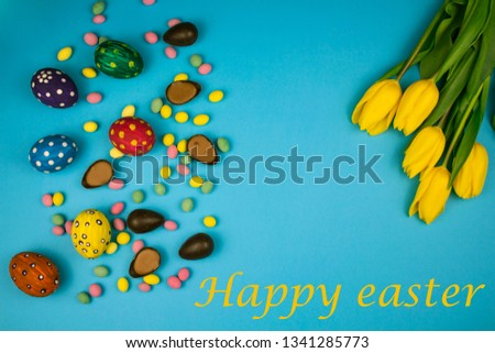 Easter eggs.Easter background with Easter eggs and spring flowers. Top view with copy space.Copy space #1341285773