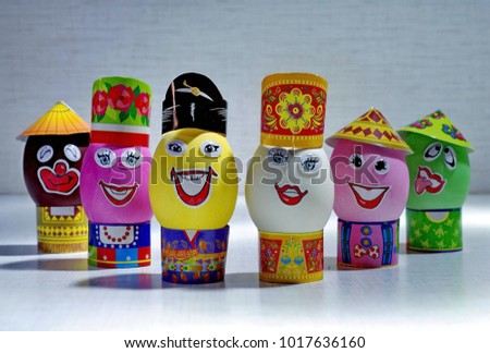 Easter eggs. Happy Day Bright Easter! Orthodox Easter holiday. Easter eggs with smile in hats. Closeup. Spring. Russia