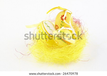 Easter eggs in a yellow nest - stock photo