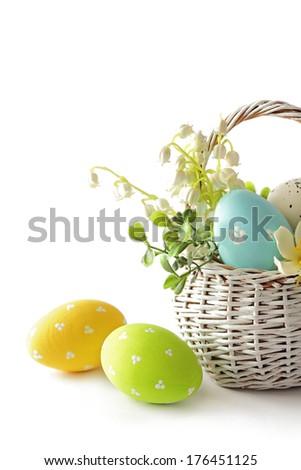 easter eggs in basket isolated on white background   Dodaj do lightboxa?     znajd? podobne obrazy    Udost?pnij? Basket with easter eggs on white background  Zdjęcia stock ©