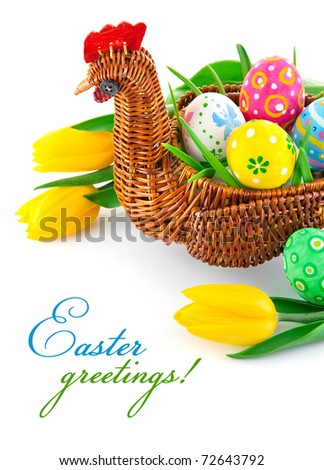easter eggs in basket with yellow tulip flowers isolated on white background