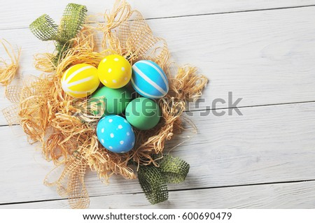 Easter eggs in the nest. rustic white background #600690479