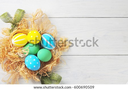 Easter eggs in the nest. rustic white background #600690509