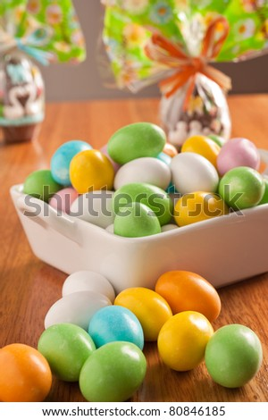 easter eggs on a wooden table with some decoration element