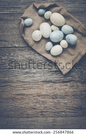 Easter Eggs on Rustic Wooden Background with Retro Instagram Style Filter