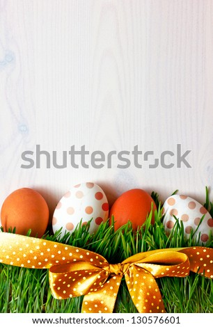 Easter eggs on the grass Background with easter eggs and green grass